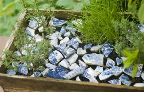 Pieces of worn blue china, in a box containing herbs. Some was gathered along the Thames river bank at low tide, and the rest collected when digging our garden in Kingston - we later found out it was on the site of an old tile factory.